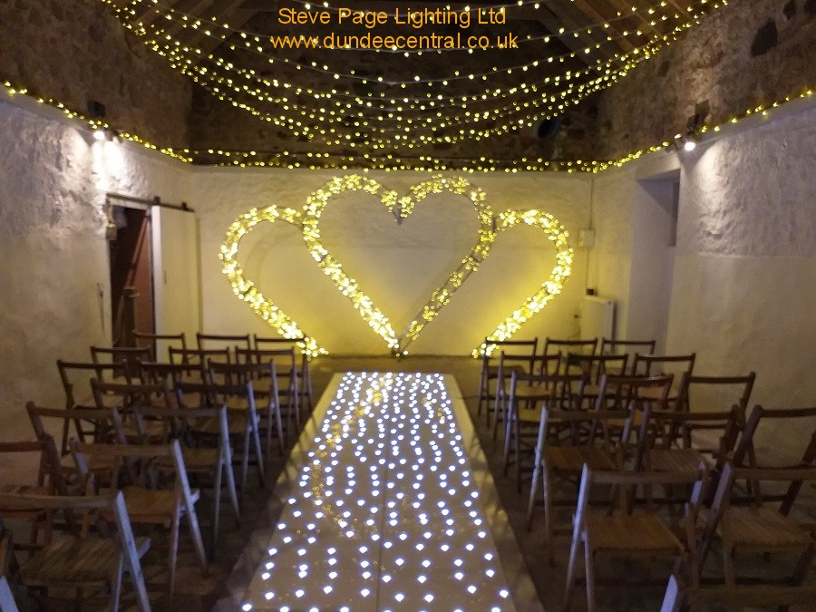 cow shed white barn ceremony lights